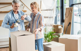 Senior couple packing to move