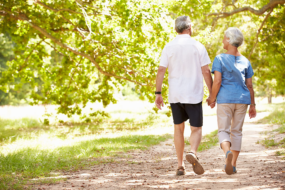 Senior couple walking outside together