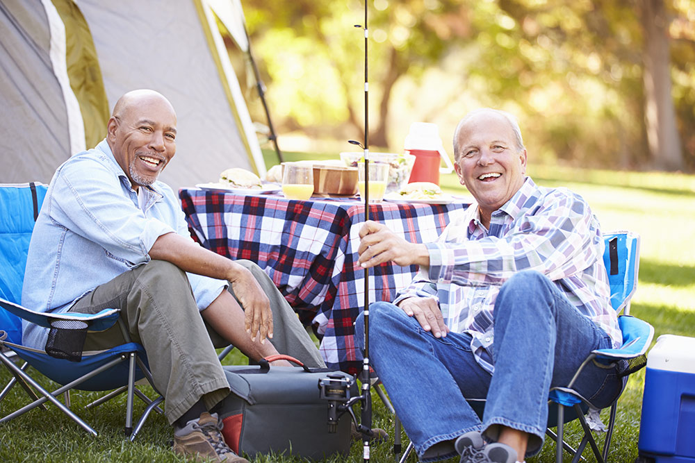 Two senior men happy on fishing trip at camp