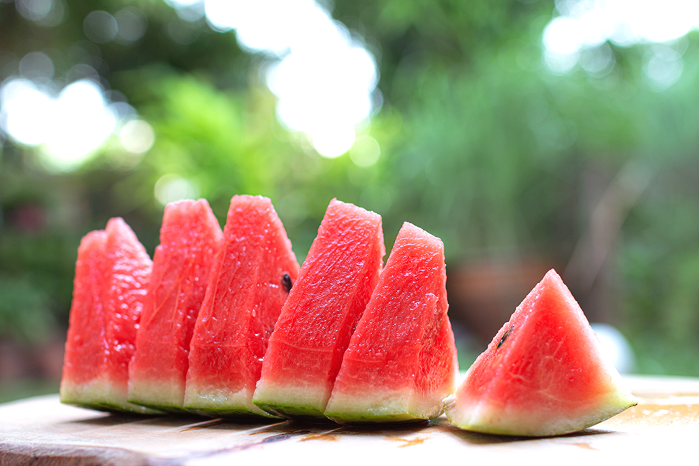 Sliced watermelon on table outside