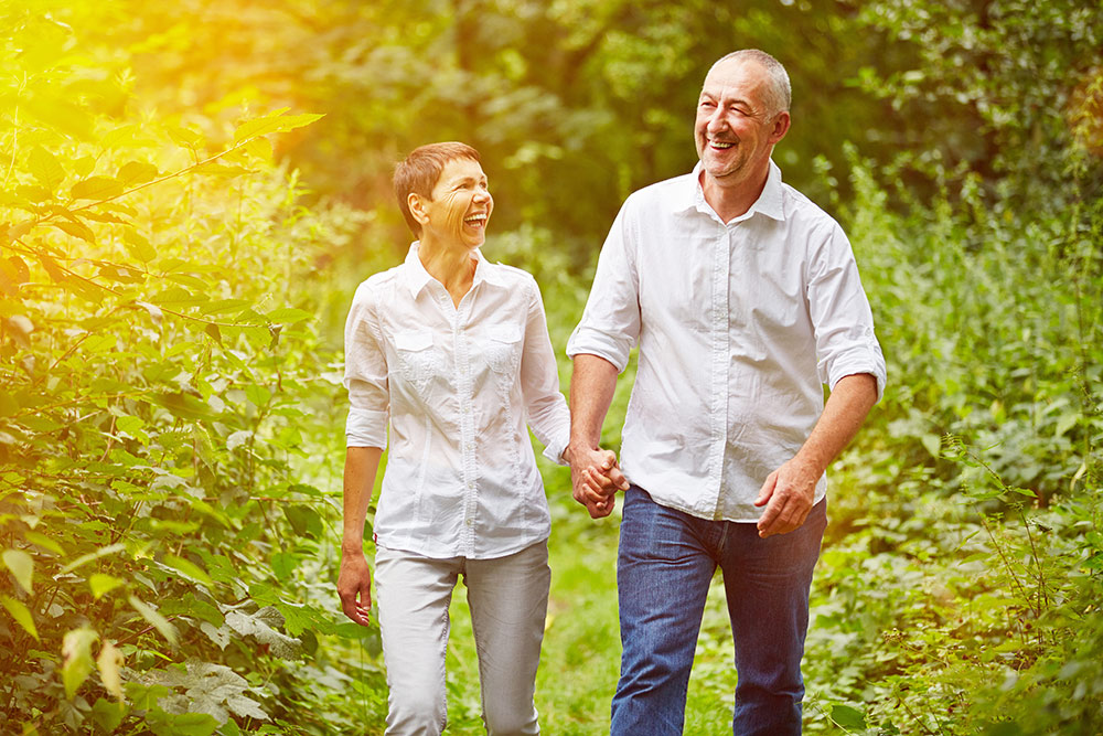 Senior couple happy and walking outside